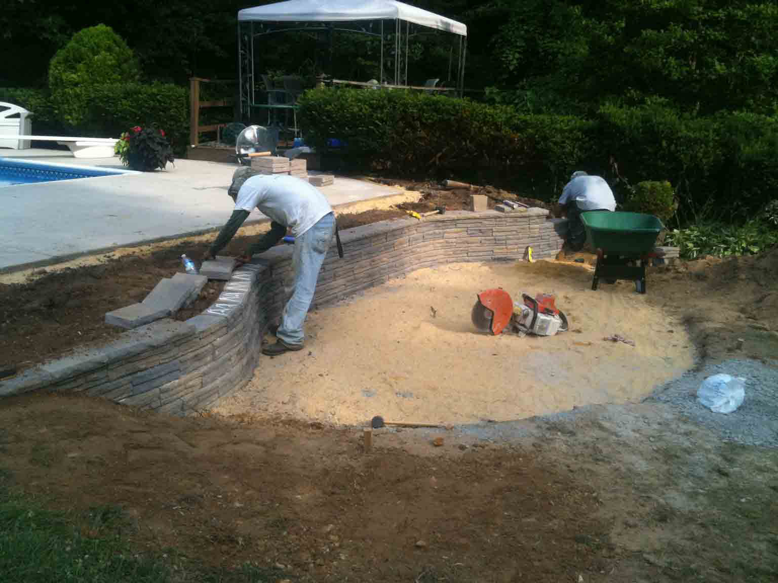 installing pool landscaping and wall | LawnArtists