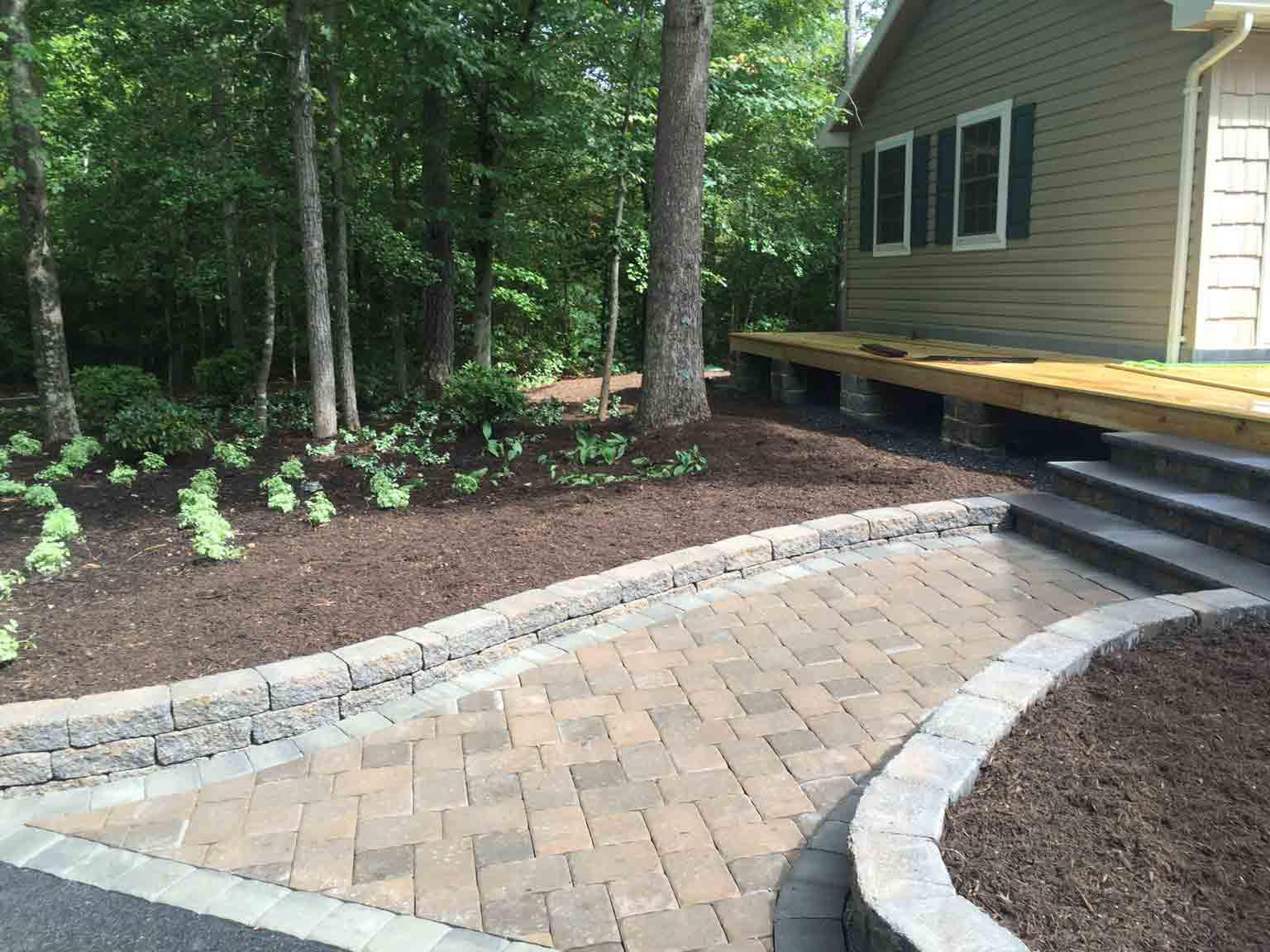 custom walkway and backyard landscape | LawnArtists